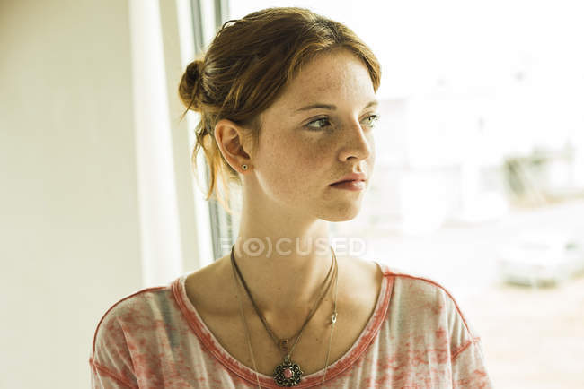 Redheaded young woman looking away — Stock Photo