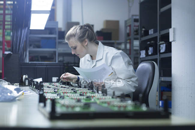 Technician working on circuit boards — Stock Photo