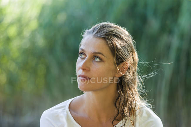 Beautiful woman with wet hair looking sideways — Stock Photo