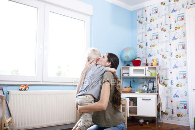 Mother and little son together at children's room — Stock Photo