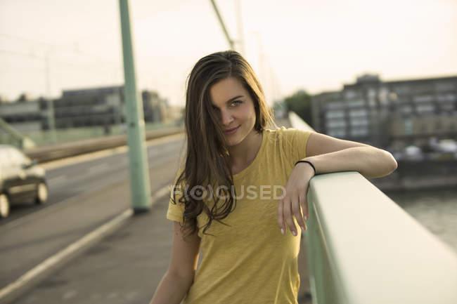 Woman standing on Rhine bridge — Stock Photo