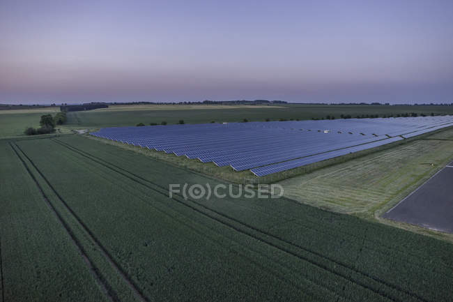 Germany, aerial view of solar fields at Nothern Harz foreland at evening twilight — Stock Photo
