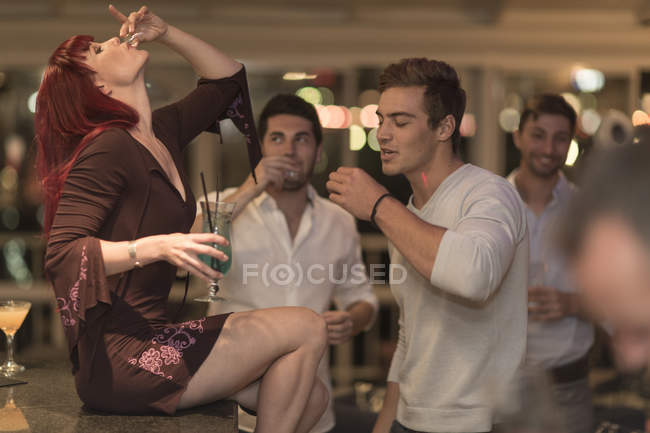 People drinking schnaps at party in bar — Stock Photo