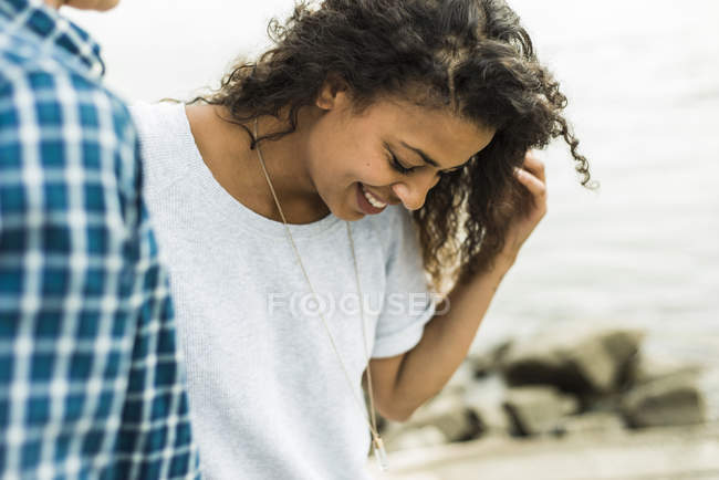Smiling young woman with man outdoors — Stock Photo