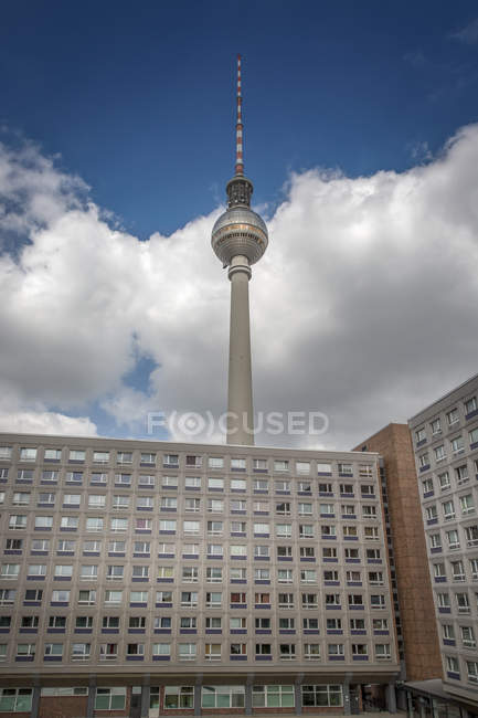 Germany, Berlin, view to television tower with concrete tower block in the foreground — Stock Photo