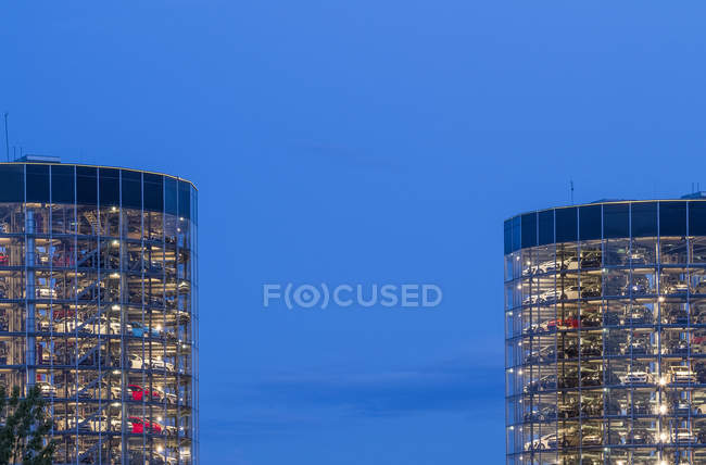Germany, Wolfsburg, Autostadt, Car Towers at dusk — Stock Photo