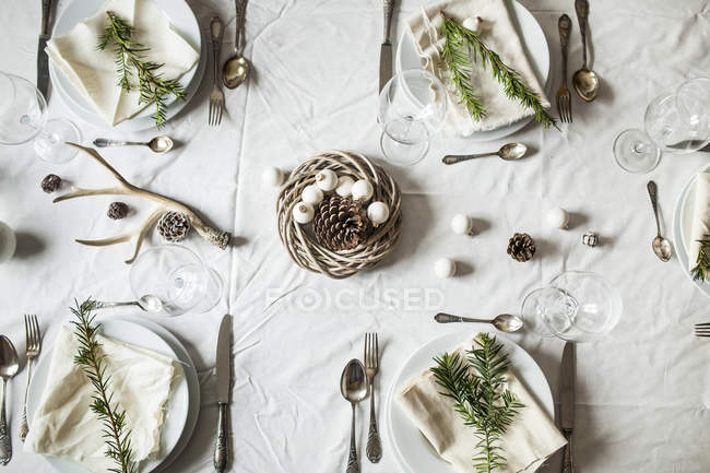 Top view of served festive laid table with christmas baubles — Stock Photo