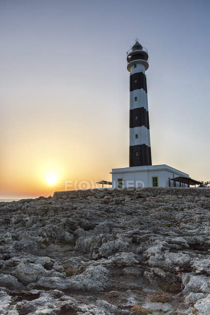 Iew of Artrutx lighthouse at sunset — Stock Photo