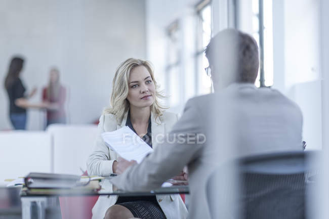 Consultant advising a client in office — Stock Photo