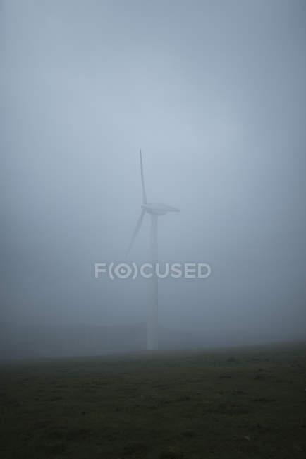 Spain, Ortigueira, wind turbine at heavy fog — Stock Photo