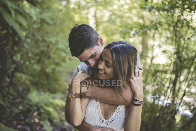 Happy Couple in love at a forest — Stock Photo