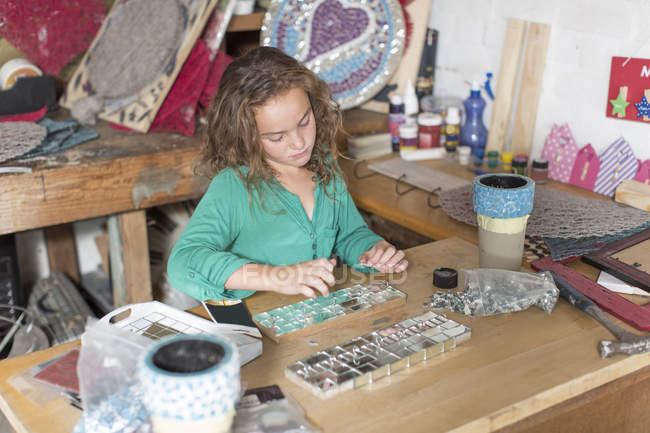 Girl doing crafts in home garage — Stock Photo
