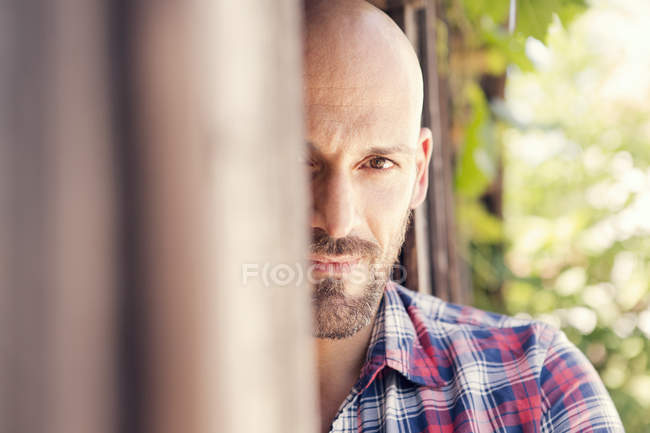 Portrait of bald man wearing checked shirt — Stock Photo