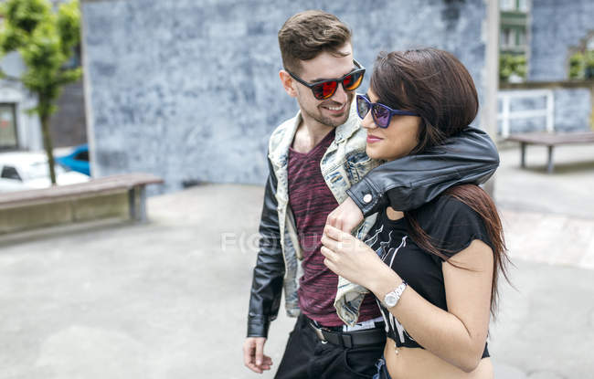 Young couple in love walking on the street — Stock Photo