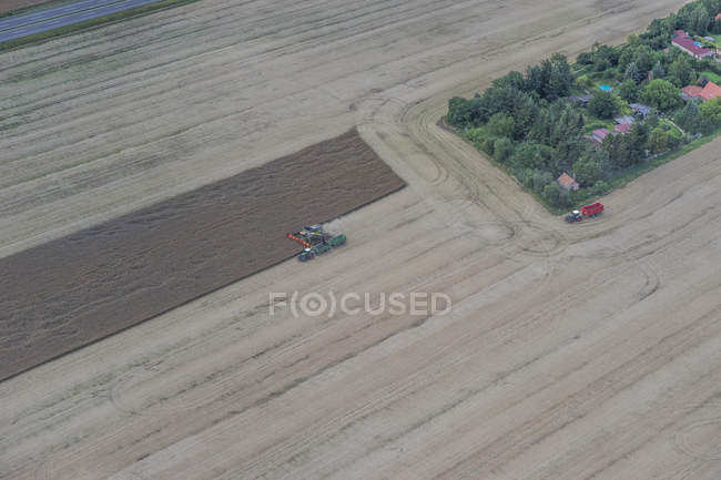 Aerial view of combines harvester at work on field at daytime, Germany — Stock Photo