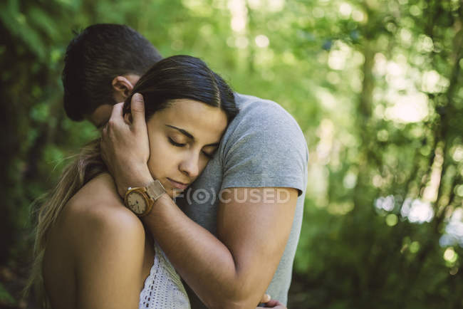 Young woman resting head on chest of boyfriend — Stock Photo