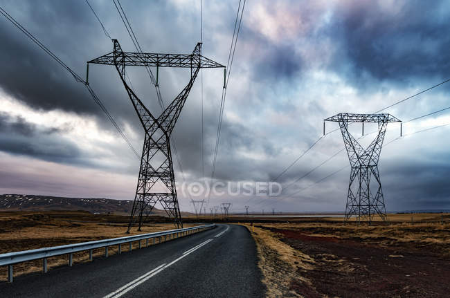 Iceland, Solheimar, Highway 354 and power poles under clouded sky — Stock Photo