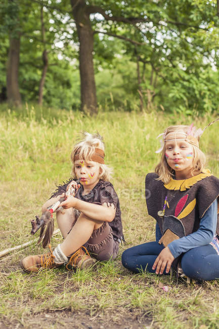 Germany, Saxony, Indians and cowboy party, Kids smoking pipe of peace — Stock Photo