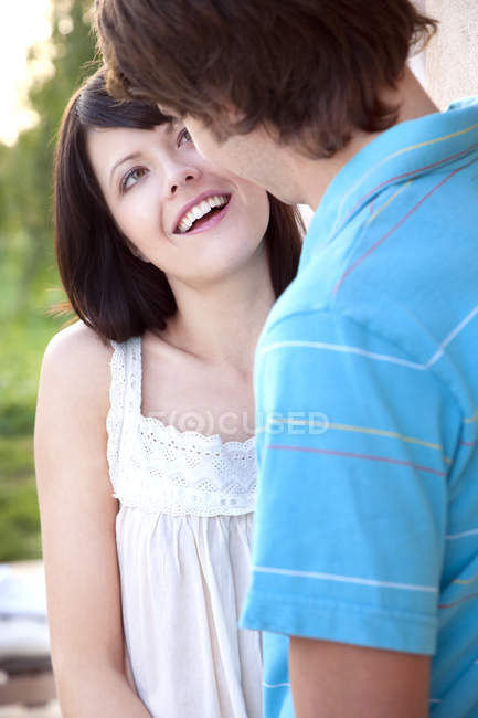 Young couple in love talking outdoors — Stock Photo