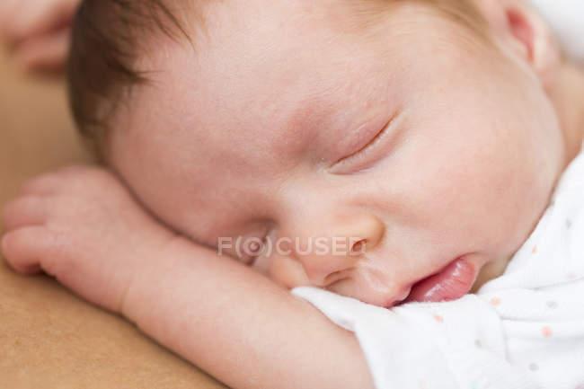 Close-up of Sleeping newborn baby girl — Stock Photo