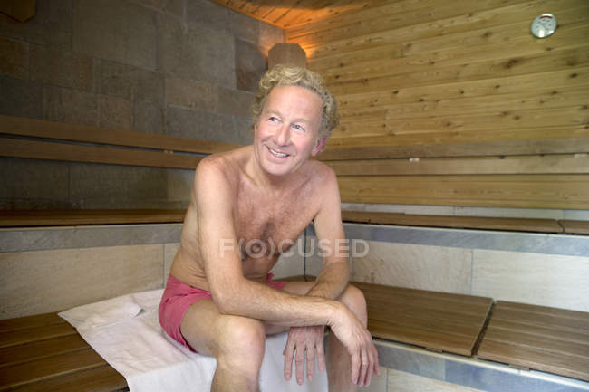 Smiling senior man in a sauna — Stock Photo