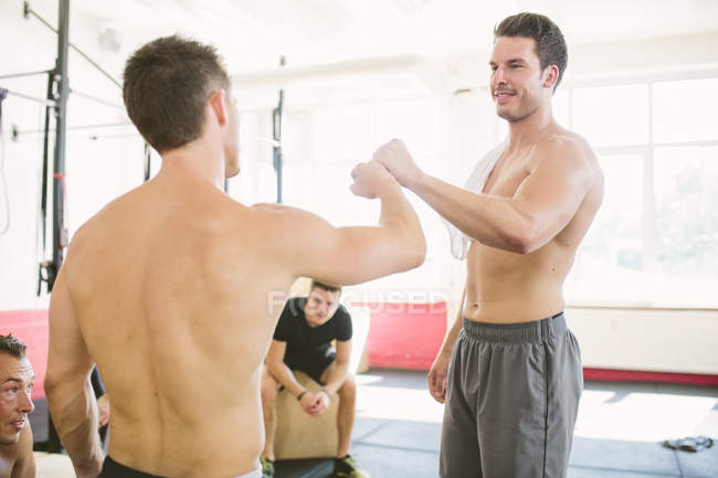 CrossFit athletes doing a fist bump after exercising — Stock Photo