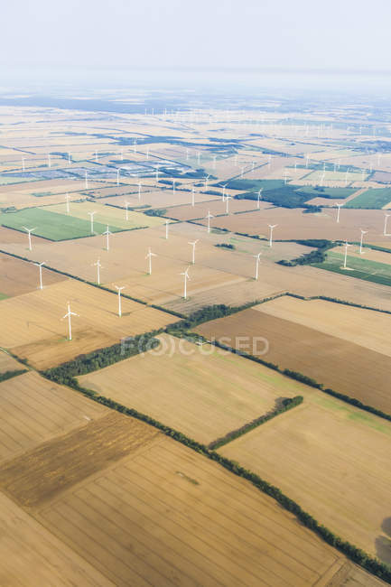 Germany, Brandenburg, Aerial view of wind park on harvested fields — Stock Photo