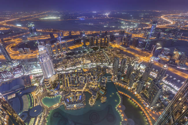 United Arab Emirates, Dubai, aerial view from the Burj Khalifa over Burj Khalifa Lake, Souk Al Bahar and the Dubai Creek at night — Stock Photo