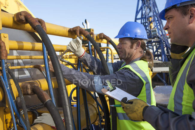 Adult caucasian crew working onboard a ship — Stock Photo