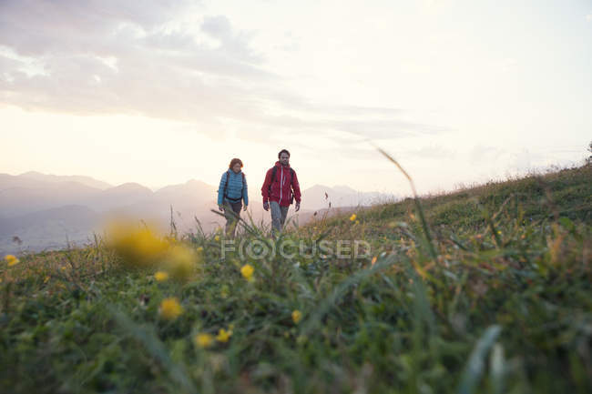 Austria Tyrol Couple Hiking At Unterberghorn At Sunrise