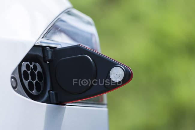 Open tank cap of an electric car — Stock Photo