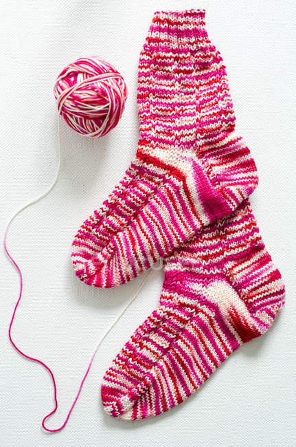 Hand-knitted pair of woolen socks — Stock Photo