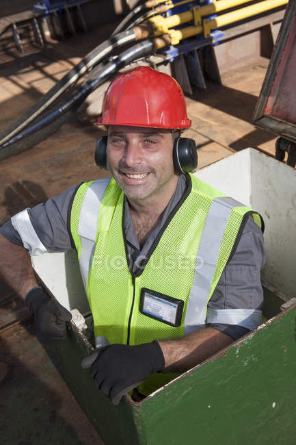 Portrait of smiling mechanic onboard a ship — Stock Photo