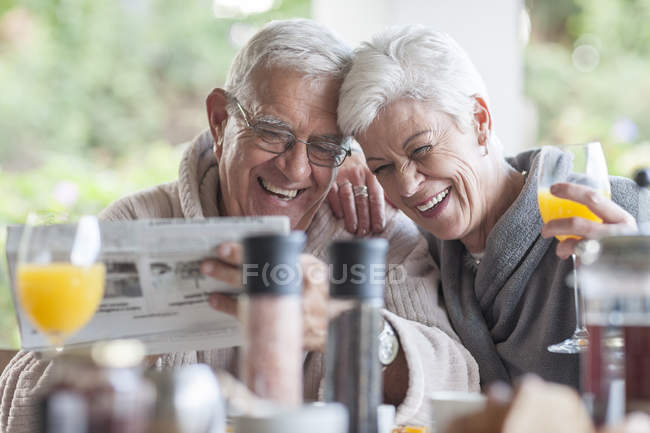 Senior couple having breakfast together on the terrace — Stock Photo