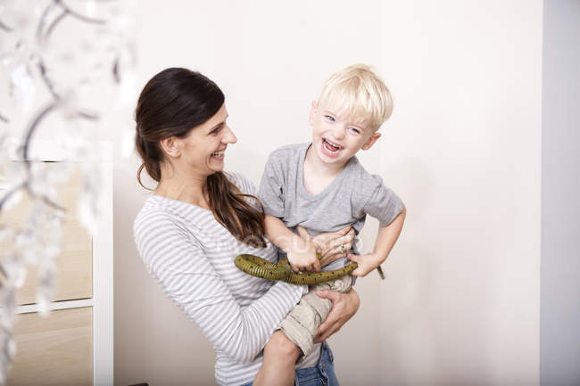 Woman tickling her little son — Stock Photo