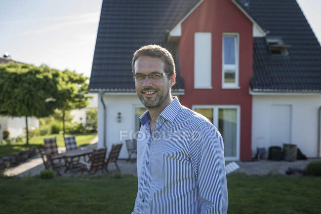 Portrait of proud house owner outdoors — Stock Photo