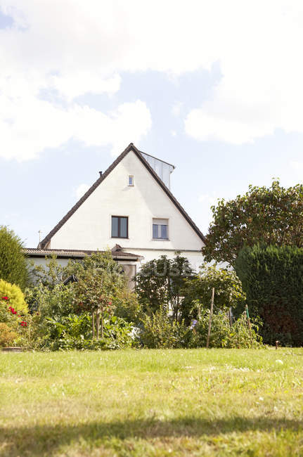 Germany, one-family house with garden in the foreground — Stock Photo