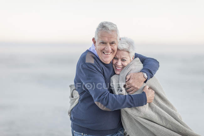 Portrait of senior couple on the beach — Stock Photo