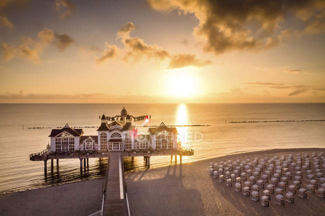 Germany, Ruegen, Sellin, sunset at pier over water — Stock Photo