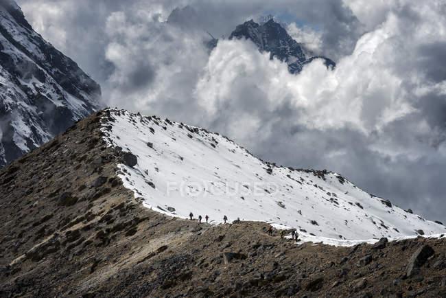 Nepal, Himalaya, Solo Khumbu, Ama Dablam, group of Gurkhas trekking on ridge — Stock Photo