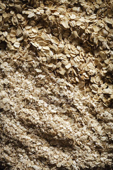 Closeup view of different oat flakes background — Stock Photo