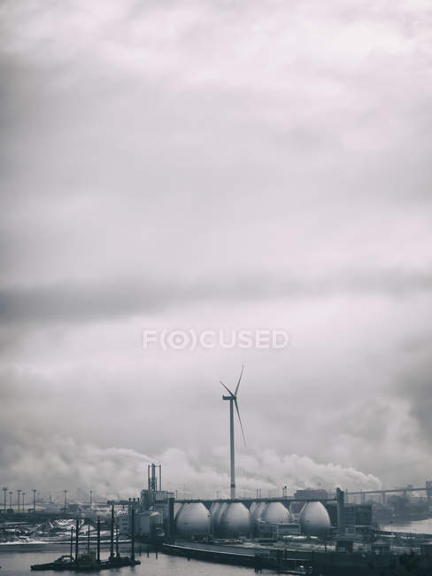 Germany, Hamburg, Industrial area and wind wheel — Stock Photo