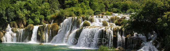 Natural landscape with waterfall — Stock Photo