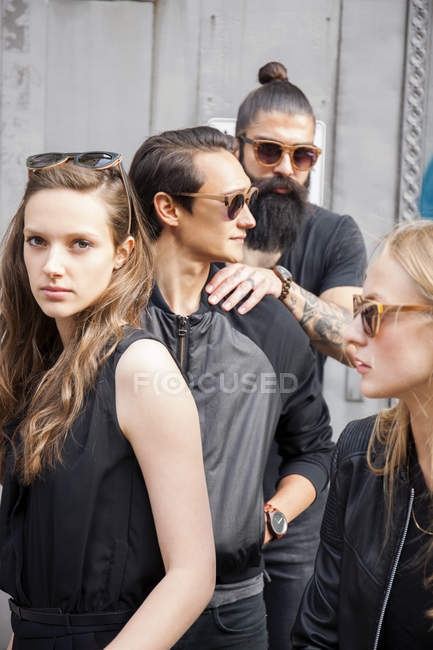 Portrait of four funky friends wearing black clothing — Stock Photo