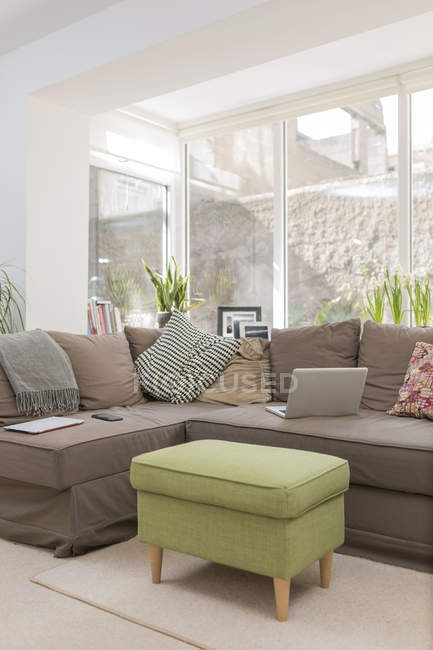 Couch with laptop in a living room — Stock Photo