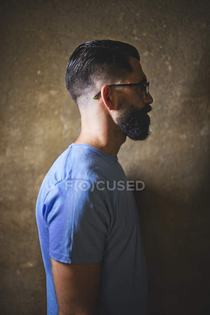 Closeup portrait of male hipster on beige wall background — Stock Photo