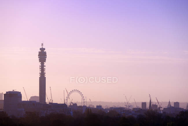 UK, London, skyline with BT Tower and London Eye in morning light — Stock Photo