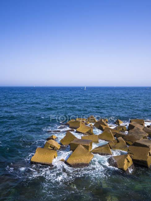 Spain, Barcelona, La Barceloneta, breakwater at Port Olimpic — Stock Photo