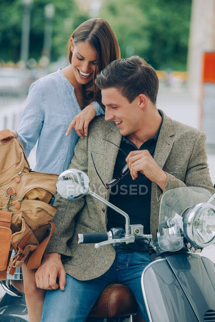 Young couple on motor scooter — Stock Photo