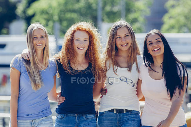 Group picture of four friends on the street — Stock Photo